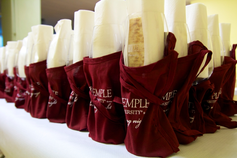 Students get a Temple Rome wine glass, bag, napkin, and crackers.