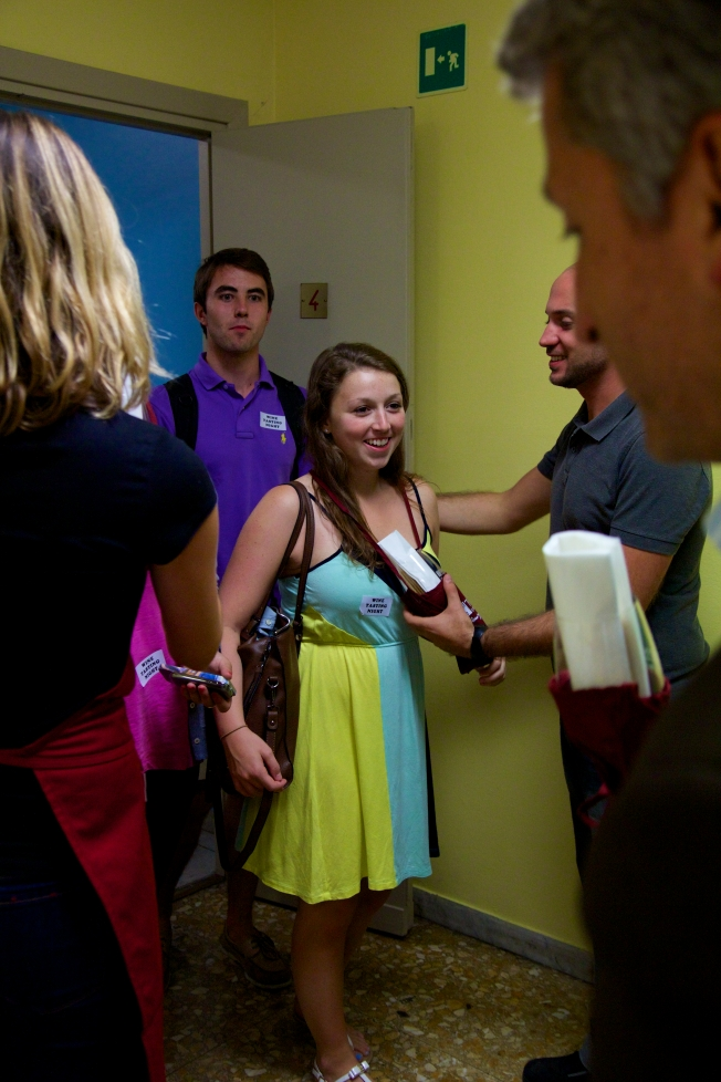 Students receive their wine glass when they enter the room.