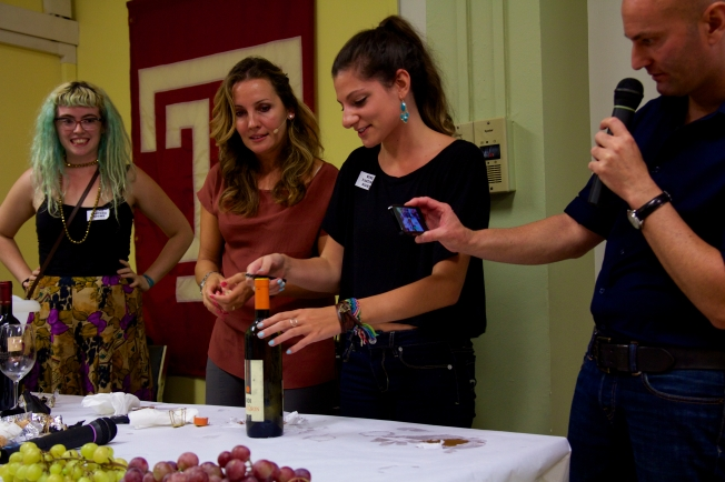 Students learn how to bottle a bottle of wine.