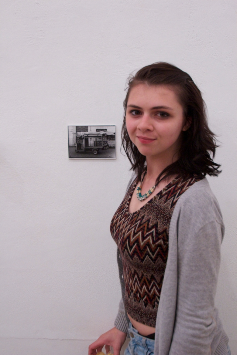 Photo student Emma standing next to her tiny photo