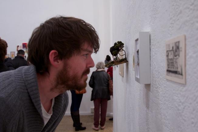Grad Student Haigen looking realy close at his art.