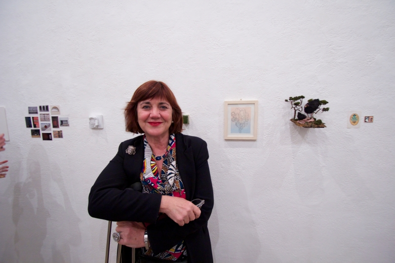 Temple Rome Professor Anita Guerra standing next to her tiny painting