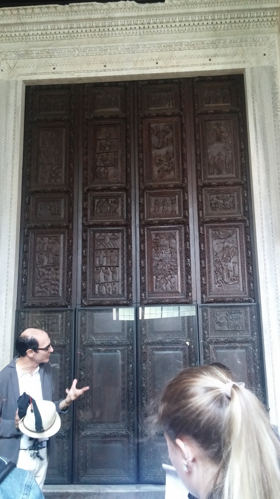 Prof, Carloni explaining that this door is still the original wooden door in santa Sabina, a church built in the fifth century