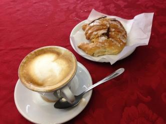 A typical Italian breakfast: un cappuccino e un cornetto con nutella