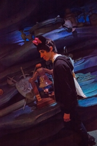 """TUJ student Carlos Casademont rings the bell in Ariel's cave, just like in the movie """"The Little Mermaid."""""""
