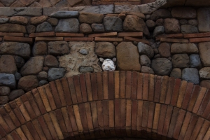 In the Tokyo Disney Resort, you can journey on a quest to find all the hidden Mickey's around the park. This one here was difficult to find, but we found him hovering just over the keystone.