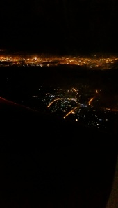 Aerial view of the city lights prior to landing