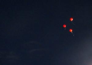 Victory Day balloons illuminate the night sky