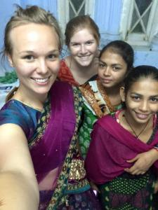 Becoming fast friends with the girls who cooked for us! They helped me and Francesca put on our sarees.
