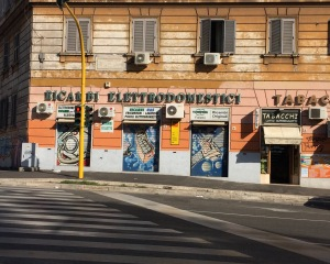 Space station cartoon spray painted onto store front across from the Arulian Wall