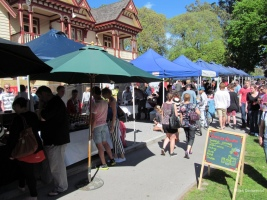 Some stalls at the weekly Christchurch Farmer's Market, which also features buskers. (photo courtesy of ChCh Farmer's Market)