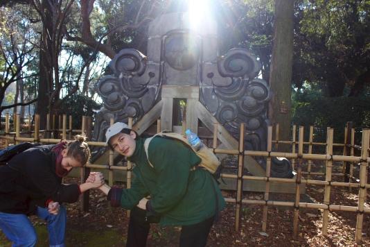 Kya Kerner and Alex Hadley kneeling outside National Tokyo Museum
