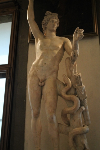 Apollo- the snake is from the story of Apollo slaying Pythos to become the patron of Delphi