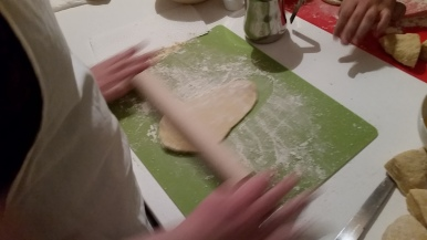 rolling out pasta dough
